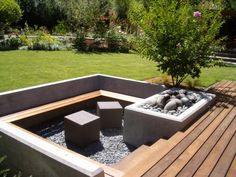 sunken bench seating area - if I built this in my uk garden it would soon be full of water!