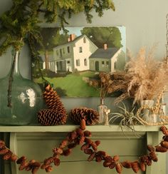 How-To: Pine Cone Garland from Amy Merrick on Design*Sponge. i like the simplicity of this