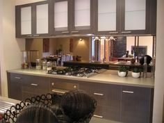 kitchen mirror splashback - great to clean, and useful to watch the kids while cooking/cleaning up.