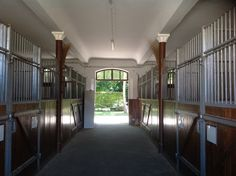 Swiss National Stud: Eight stables per aisle, with large door and windows at each end.