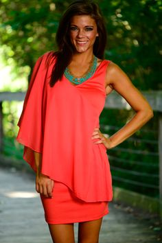 This coral dress is stunning! This dress will have people's heads turning your way! The fit is super comfy and the sheer, cross-shoulder detail is amazing!