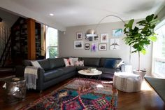 If you like the texture of a Beni Ourain rug but need some more color in your life, try aboucherouite rug. These colorful rugs are often made from recycled materials with the result being a one-of-a-kind masterpiece. Jenny Norris uses a boucherouite rug to add a pop of color to this living room.