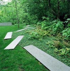 Stainless steel planks create a meandering path (Michael Van Valkenburgh Associates, Inc.)