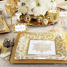 Have fun designing this year's holiday look by experimenting with a new color scheme. Try metallic Shimmering Snowflake plates and napkins as a starting point, then add a white poinsettia centerpiece, white votive candles, place cards and classic stemware to round out your chic holiday tablescape.