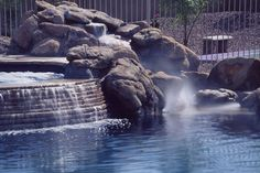 Stacked stone waterfall from #spa and rock waterfall into the #pool. http://calpool.com