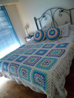 Crochet - granny squares blanket and round crochet pillows.