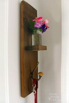 DIY Reclaimed Wood Sconce with Hook tutorial from Pretty Handy Girl at TidyMom.net also can turn the other way and put a row of hooks.  Reclaimed barn wood...