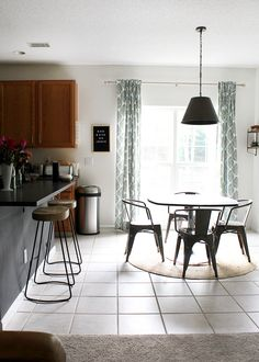 new modern wood barstools in the kitchen