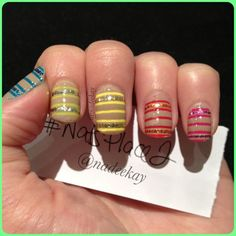 hand placed glitter stripes on nude nail art design