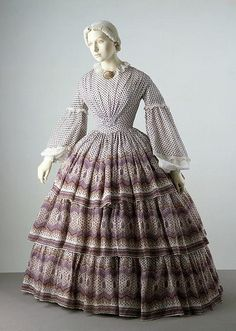 c.1858-1860 Day Dress, deep mauve polka dot and border print, 3-tired skirt.
