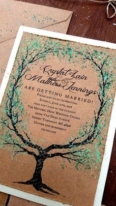 Woodland wedding invitations on kraft paper featuring a palette of greens and gold shimmery leaves. Both rustic and elegant! Great invitations for an outdoor summer wedding. Leaf color can be changed for a fall wedding invitation. Green and gold details on these rustic wedding invitations are hand painted. The kraft paper invitation is backed by a light sage green shimmer cardstock. Each invitation set comes with rsvp card and envelope and an invitation envelope. Thin twine ties everything…