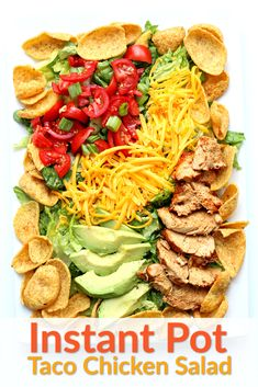 Instant Pot Chicken Taco Salad--seasoned, tender slices of chicken served atop a bed of romaine lettuce with tomatoes, Fritos, green onions, avocados, cheese and dressing. Chicken is cooked in your Instant Pot or slow cooker. #instantpot