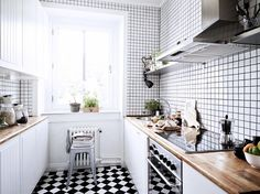 Scandinavian kitchen with grid tile walls and floors