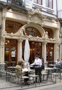 "Café Majestic, Porto - absolutely stunning cafe in Portugal. One might imagine that a cup of coffee is quite expensive here, or perhaps it being Portugal, it may still be ""cheap"" compared to Starbucks! The Places Youll Go, Places To Go, Magic Places, Sidewalk Cafe, Café Bar, Outdoor Cafe, Cafe Bistro, Algarve, Store Fronts"