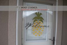 DIGITAL DOWNLOAD - a finished photo showing how the pineapple designs @ My Vinyl Designer can be used as vinyl lettering on the front door (http://www.myvinyldesigner.com/Products/modern-wall-art-5.aspx)