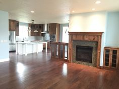 for more info on this fireplace, great room, built-in and kitchen see our custom homes http://www.callcypresshomes.com/home-types/custom