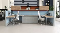 The color palette of these cubicles has a splash of industrial.  The wood tone on the overhead storage warms up the look.    #officedesign #industrialoffice #cubicles