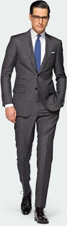 Charcoal grey suit with blue tie