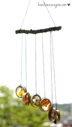 Homemade Nature Suncatcher Wind Chimes Made with Mason Jar Rings and Pressed Flowers.