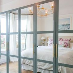 an IKEA Pax wardrobe with fully mirrored front panels with aqua frames and brass. - Home Decor -DIY - IKEA- Before After Bedroom Closet Doors, Mirror Closet Doors, Bedroom Wardrobe, Master Bedroom, Mirrored Wardrobe Doors, Entryway Closet, Wardrobe Closet, Master Closet, Ikea Wardrobe Hack