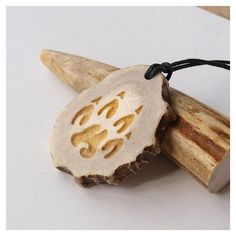 Wolf paw necklace pendant charm print handcrafted out of deer antler ❤ liked on Polyvore featuring jewelry, necklaces, charm pendant, cotton jewelry, pendant jewelry, handcrafted jewellery and handcrafted jewelry