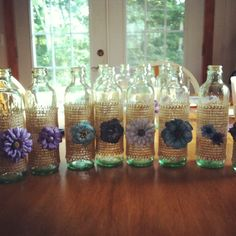 Small glass coke bottles I turned into vase centerpieces for my upcoming wedding:)