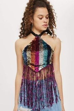 Elevate your festival style in our sequinned halter neck top. This cropped style is embellished with rainbow sequins and finished with a fringe trim. We're styling ours with denim shorts. Music Festival Fashion, Festival Outfits, Festival Style, Festival Gear, Festival Clothing, Topshop Tops, Body Carnaval, Sequin Outfit, Sequin Crop Top