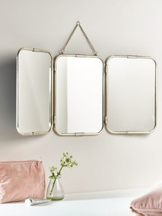 Feminine and French-inspired with delicate bevelled edging, this large version of our bestselling triple frame mirror has hinges to fold and a chain for hanging. Open fully to hang on the wall or fold the outer mirrors in to sit on your dressing table. With metal edging and a faux leather back, it makes the perfect addition to your bathroom.