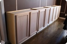 Use upper cabinets for base of server in DR or top with counter and use open shelving above.