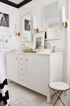 Sconce, mirror, cabinet and brass fixtures