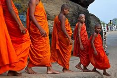 Asia Sri Lanka Eastern Province Trincomalee District Trincomalee A group of young novice Buddhist monks visiting at the Koneswaram Temple in Trincomalee It is a classical-medieval Hindu Temp - stock image