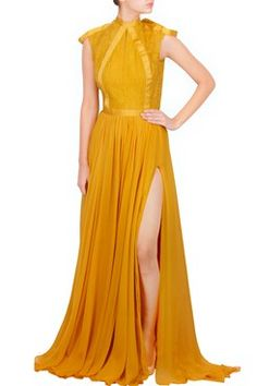 Featuring a mustard yellow front slit gown in silk chiffon with chantilly lace bodice with key hole and ribbon detailing by Amit GT Shop now-www.carmaonlineshop.com