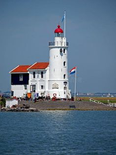 The Paard van Marken is a lighthouse on the Dutch peninsula Marken, on the IJsselmeer, The Netherlands. It was built in 1839 by J. Valk. This current lighthouse is a Rijksmonument since 1970.