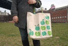 Apple/fruit-stamped canvas bag. Would be great for kitchen towels/drapes and table cloths.