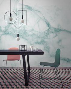 This marbled wall paper is a great way to add coordinated color to a space that has a tiled floor as busy as this one!