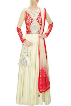 This ivory chanderi pleated anarkali is featuring with contrast silver and fuchsia floral applique work embellished bodice. It comes along with matching churidaar pants and ivory net dupatta with fuch
