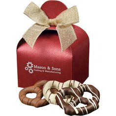 Bavarian-Style Pretzels covered with Belgian Milk, White and Dark Chocolate come packed in a red gift box with your choice of a gold or silver imprint.
