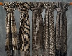 Description: 100% Silk. Hand woven and hand-dyed. Five patterns, in black and white, like a garden in winter exhibit all structure, no color. This shows the range of my work in terms of pattern.Dimensions: H:72.00 x W:9.00 x D:0.00 Inches