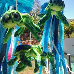 Stuffed turtles swimming around custom made paper lantern jelly fish by Pack A Perfect Party for an 'Under the Sea' theme birthday party.