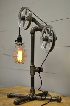*****FREE SHIPPING IN THE USA******* DESCRIPTION: This industrial table lamp is flexible enough to work in a home, retail space, or office. The pulley wheels guide the wire through the light. It also features our signature steel base which keeps the piece very sturdy. All pieces and lengths can be customized so if you need something to fit your needs, please let us know and we will make you a custom link ~ALL LIGHTS CAN BE CUSTOMIZED. IF YOU WANT SOMETHING CUSTOMIZED TO YOUR NEEDS, PLEASE…