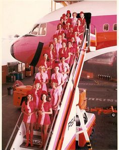 """This brings new meaning to """"pink collar."""" Braniff Airlines flight attendants in vintage Pucci uniforms and matching pink plane."""