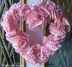 """glue gunned 75 cupcake liners on a foam heart shaped wreath form  """"Oh, if it be to choose and call thee mine,  love, thou art every day my Valentine!""""  - Thomas Hood"""