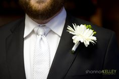 The groom's tie in the shape of a Trinity Knot, symbolising love, honour and protection