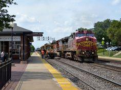 Westmont warbonnets - A pair of Santa Fe warbonnet Dash 9s lead a CSX bound oil train east through Westmont, IL.