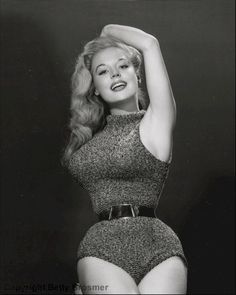 Above: popular 1950s pin up girl and model: Betty Brosmer who had a tiny waist, the result of waist-training with a corset.