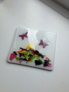 Fused glass coaster with butterflies and glass confetti by Wendysglasshouse on Etsy https://www.etsy.com/listing/200733848/fused-glass-coaster-with-butterflies-and