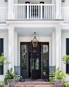 Portico with Rocking Chairs: Black rocking chairs sit on brick pavers on a portico lit by a carriage lantern hung in front of a glass paneled black front door flanked by sidelights. Front Door Entrance, Glass Front Door, Front Entrances, Entry Doors, Glass Door, Doorway, Entryway, Porte Cochere, Black Front Doors
