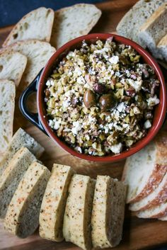 This chunky olive tapenade is flavored with lemon-infused olive oil and tangy feta - a memorable party appetizer!