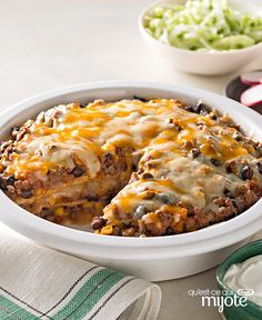 Enchiladas anyone? Ground beef, salsa, corn, black beans and cheese are layered between tortillas for an enchilada bake recipe that's like a fiesta in a dish. Enchilada Pie, Enchilada Recipes, Enchilada Casserole, Ground Beef Dishes, Ground Beef Recipes, Plats Latinos, Ground Beef Enchiladas, Cheese Enchiladas, Beef Pies