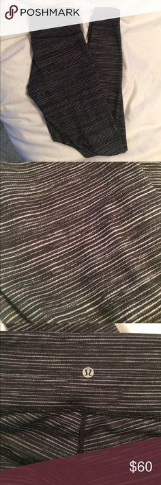 Lululemon leggings Black leggings with gray stripes.  Only worn once, so like new! No trades lululemon athletica Pants Leggings